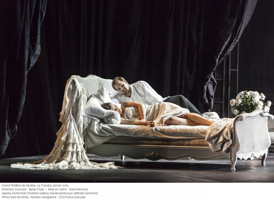 Woman and a man in a bed on stage